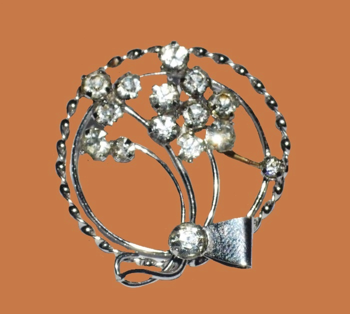 Rhinestone and sterling silver round brooch