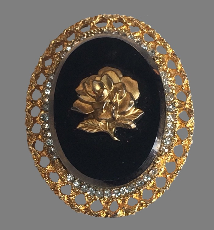 Rose oval brooch. Black glass, gold tone metal, rhinestones