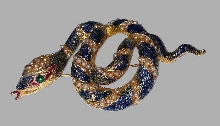 Snake brooch by Urie Mandle. Faux pearl, blue and red enamel, gold tone metal