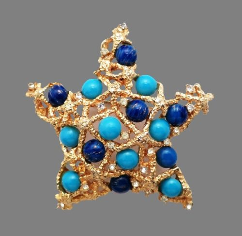Star brooch. Jewelry alloy, glass stones
