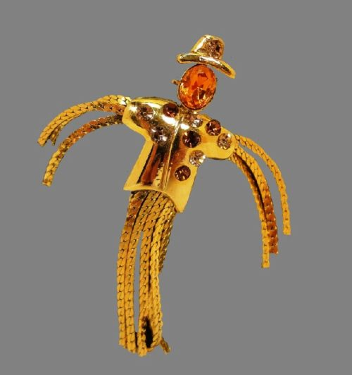 Straw Man Brooch. Goldtone, amber color crystals