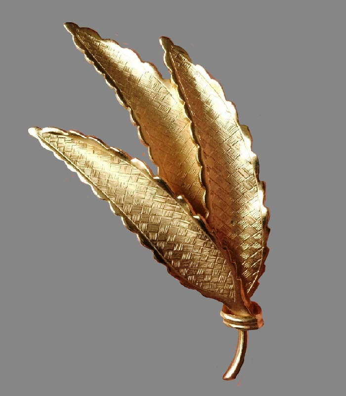 Three leaf gold tone textured brooch