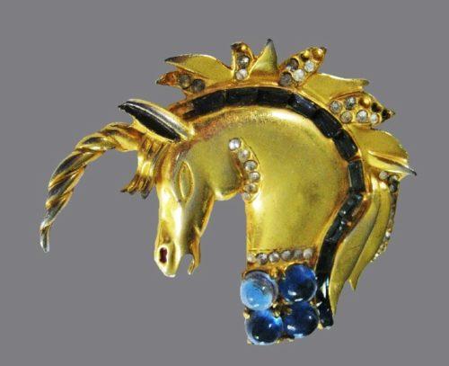 Unicorn brooch. Gold tone metal, sapphire blue cabochons, rhinestones