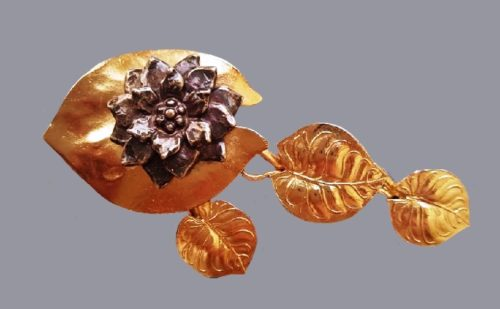 Water-lily brooch with leaves, labeled Kenzo Paris and Made in France. Leaves of jewelry alloy of gold tone, water lily flower - blackened silver