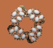 White lucite and rhinestones brooch