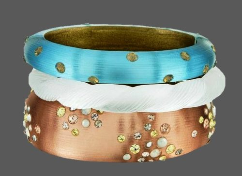 A set of lucite dust incrusted bracelets