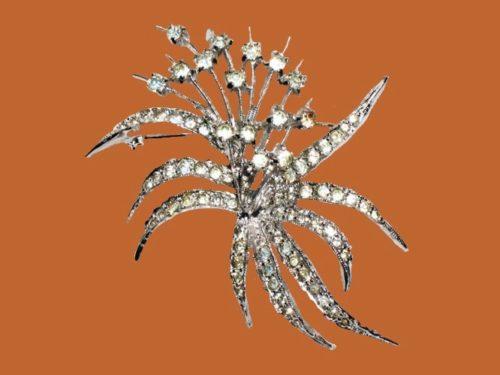 Art Deco flower bouquet brooch. Silver tone metal, crystals