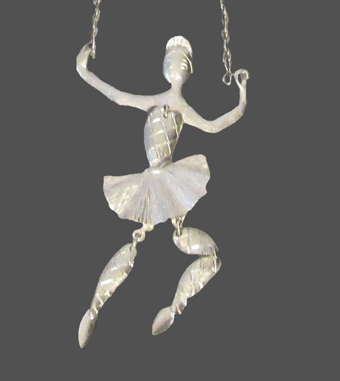 Ballerina pendant of silver tone metal