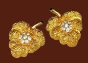 Beautiful gold tone leaf clip on earrings. Jewelry alloy, textured metal, rhinestone
