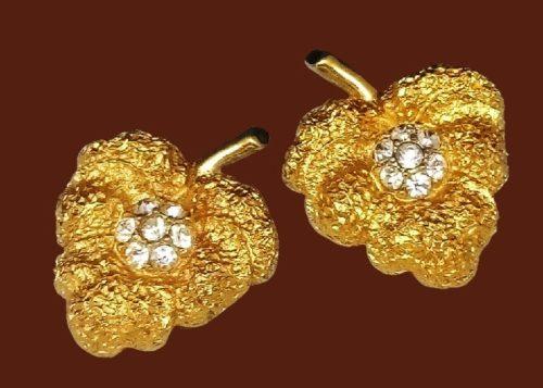 Beautiful gold tone leaf clip on earrings. Jewelry alloy, textured metal, rhinestone