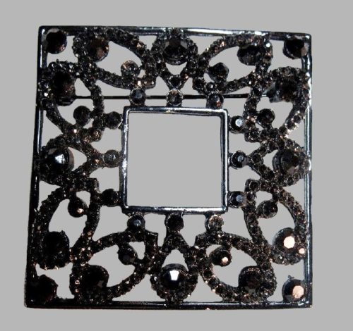 Black square brooch decorated with rhinestones