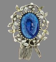 Blueberry brooch with chains - pendants. Made of jewelry alloy of aged silver, decorated with an blue cabochon. 1950s. 5.5 cm