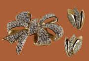 Bow brooch and earrings. Jewelry alloy of gold tone, crystals, rhinestones