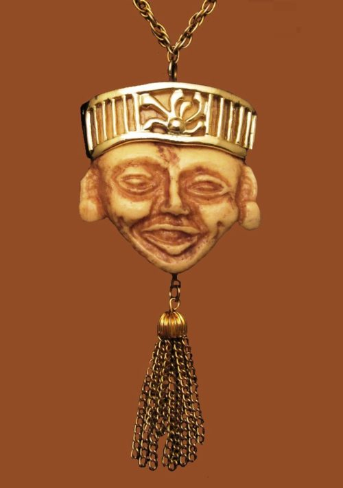 Buddha face pendant necklace. Gold tone jewelry alloy, resin