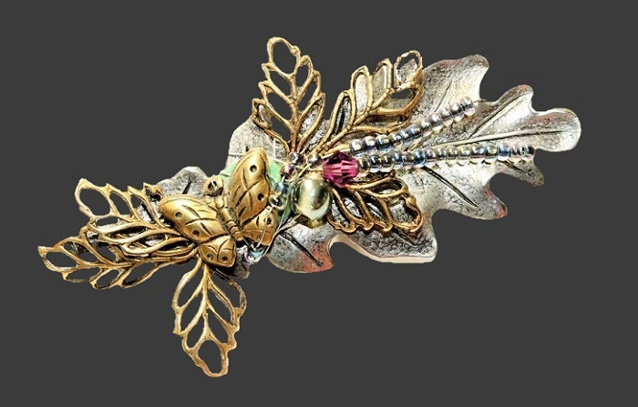 Butterfly and leaves vintage brooch. Silver tone metal, jewelry alloy of gold tone