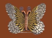 Butterfly brooch made of pewter, gold tone metal