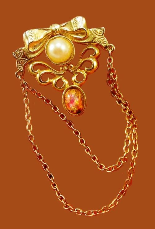 Chatelain brooch. Jewelery alloy, opal glass, faux pearls, chains