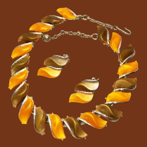 Choker necklace and clips, amber color lucite. 1950s