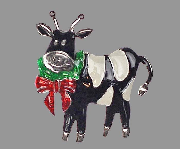 Cow Christmas brooch. Silver tone metal, white, black, green and red enamel