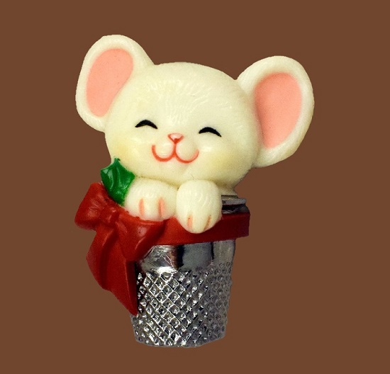 Cute little mouse in a thimble. Brooch made of plastic (polystone), textured silver. 1983. 4.3 cm