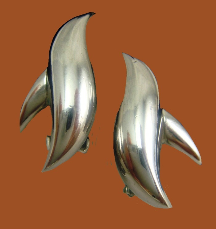 Dolphin earrings, silver tone polished metal