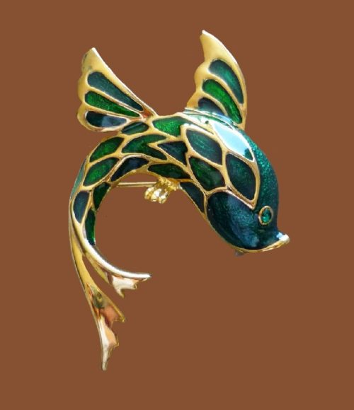 Dolphin gold tone and black enamel brooch