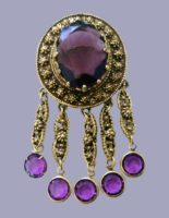 Elegant brooch in Etruscan style, 1970s. Antique gold color metal. Decorated with a large transparent crystal. 8 cm
