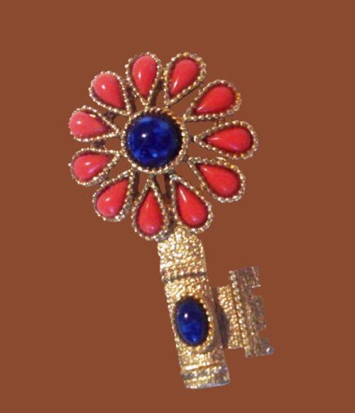 Elegant flower key brooch. Jewelry alloy, cabochons
