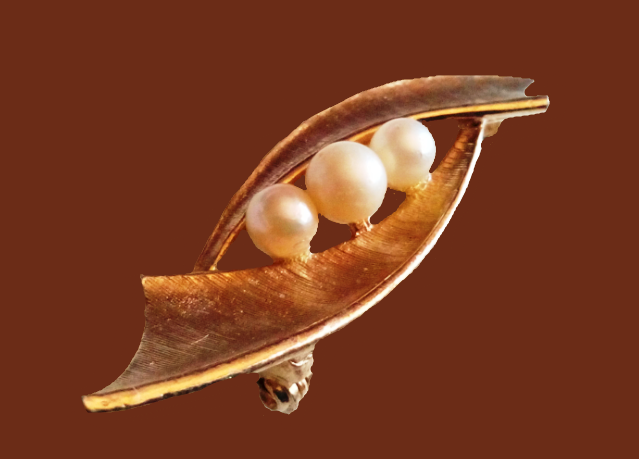 Fantasy brooch. Gold tone jewelry alloy, pearls