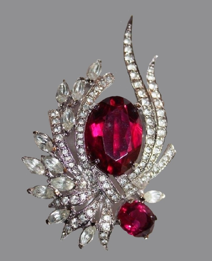 Fantasy brooch. Jewelry alloy of silver tone, faux ruby, rhinestones