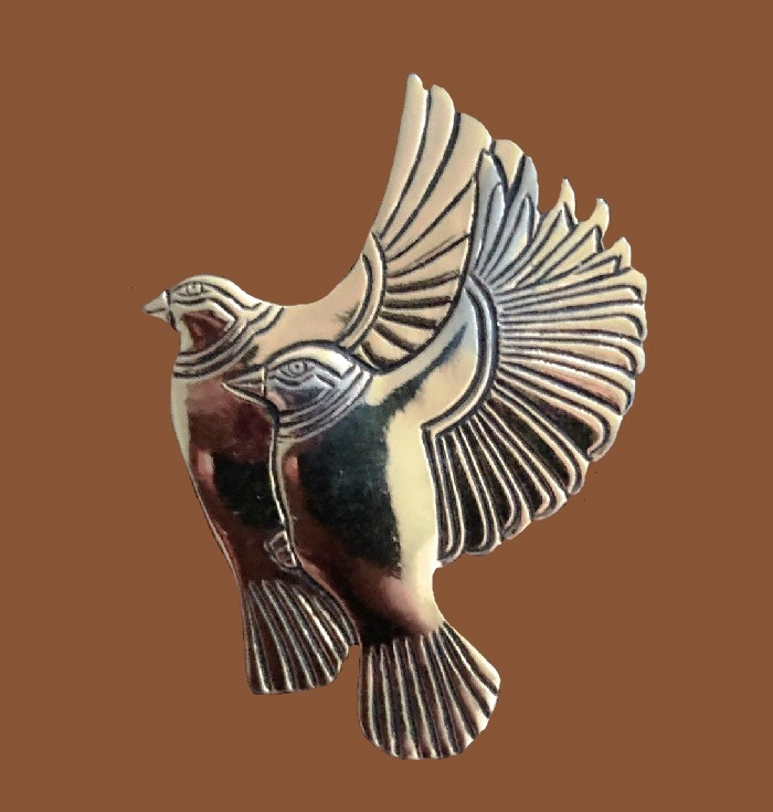 Flying bird pin