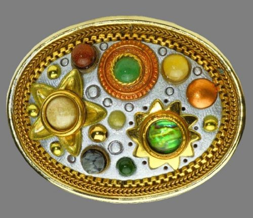From the cosmic collection 24K gold oval brooch. Jewelry alloy of gold tone, multi-color stones, cabochons, beads