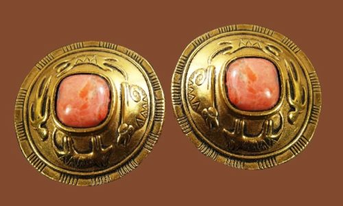 Gold tone tribal motif earrings with cabochon in the center