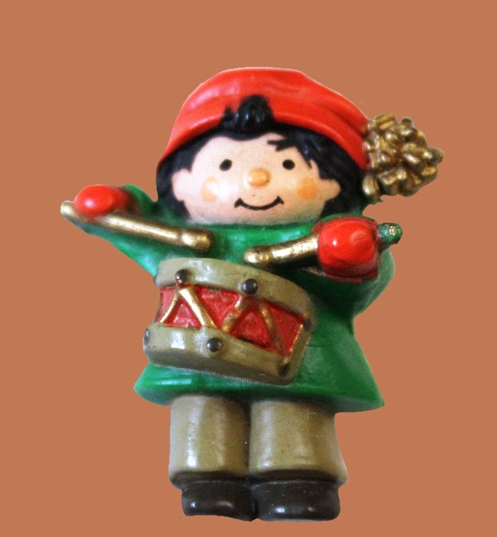 A boy with a drum. 4 cm. Jewelry plastic