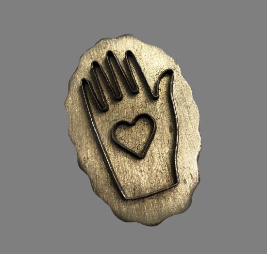 Heart in hand silver tone brooch