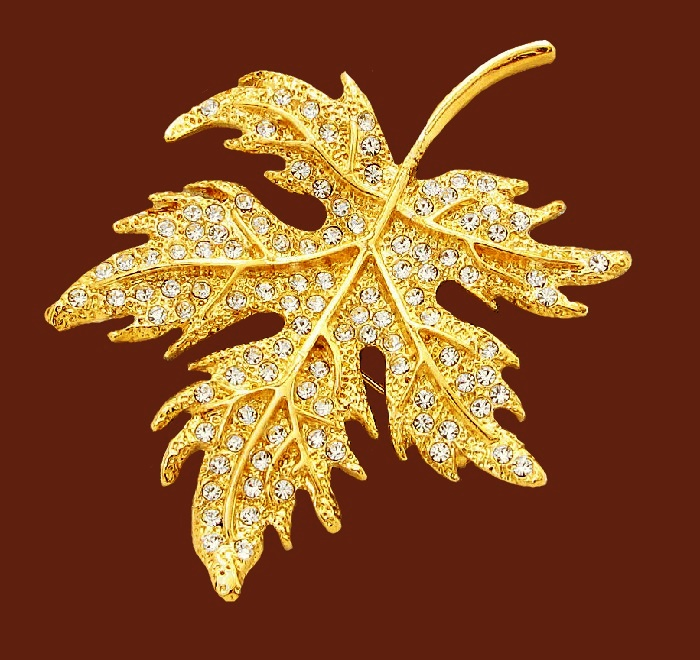 Leaf brooch. Jewelry alloy of gold tone, rhinestones