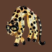 Leopard brooch. Jewelry alloy of gold tone, black enamel, rhinestones