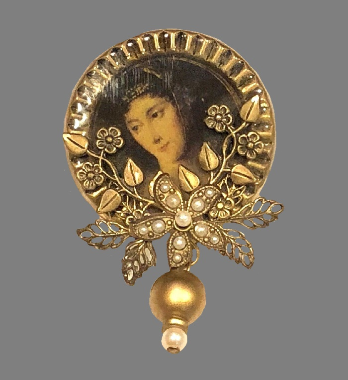 Marked Cara Stimmel ltd Victorian style cameo brooch with portrait insert. Gold tone metal
