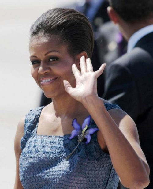 Michelle Obama wearing statement brooch Orchid