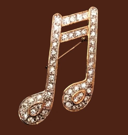 Musical note brooch pin. Jewelry alloy, transparent rhinestones