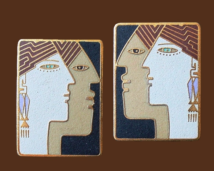 Profile double face earrings. Enamel, gold tone metal