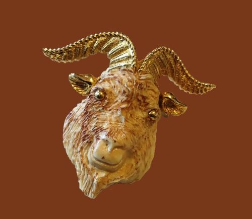 Resin carved Ram head brooch. Gold tone jewelry alloy