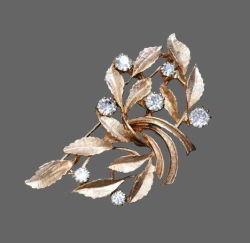 Rhinestone gold tone metal branch brooch