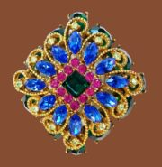 Sapphire blue vintage brooch. Jewelry alloy, gold plated, crystals