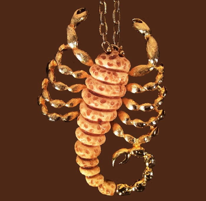 Scorpio zodiac sign pendant made of resin and jewelry alloy of gold tone