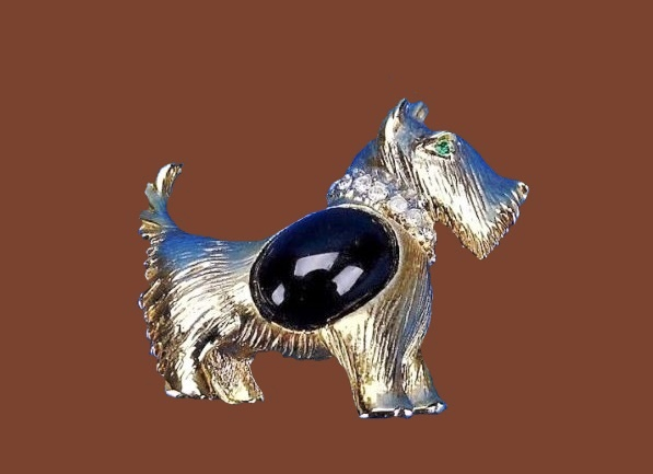 Scottie Dog brooch. Gold tone jewelry alloy, rhinestones, black cabochon