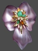 Shining flower brooch. Lucite of lavender tone with the effect of inner shine. Inlay with natural stones lambradorite and chrysoprase