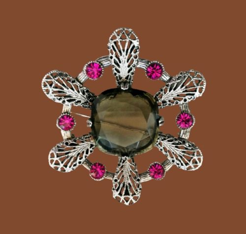 Snowflake Pendant brooch of jewelry alloy, crystals. 7.5 cm