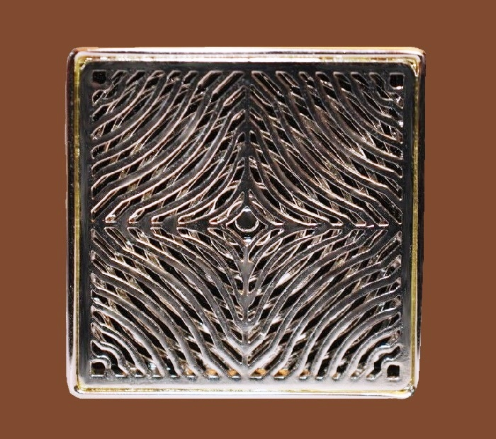 Square brooch of textured metal of blackened silver tone. 1970s
