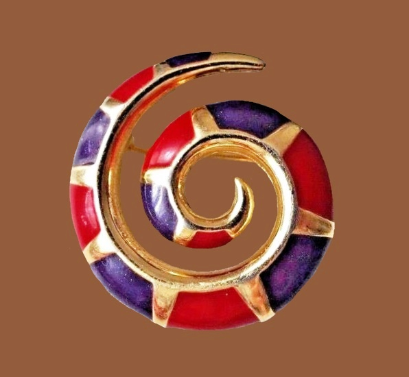 Swirl brooch of gold tone metal, red, violet enamel